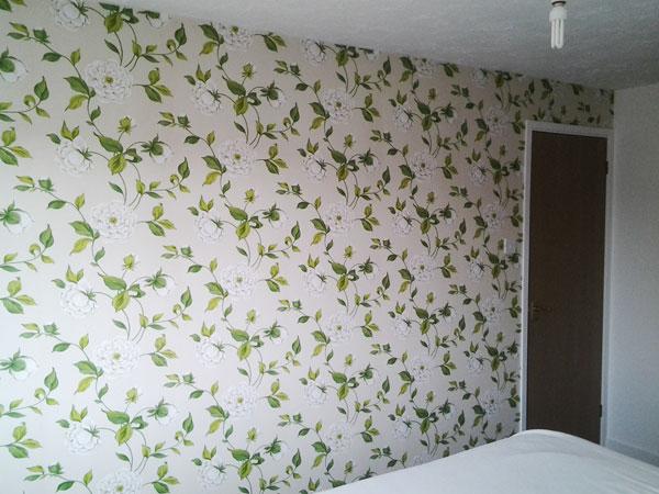 wallpapering a bedroom